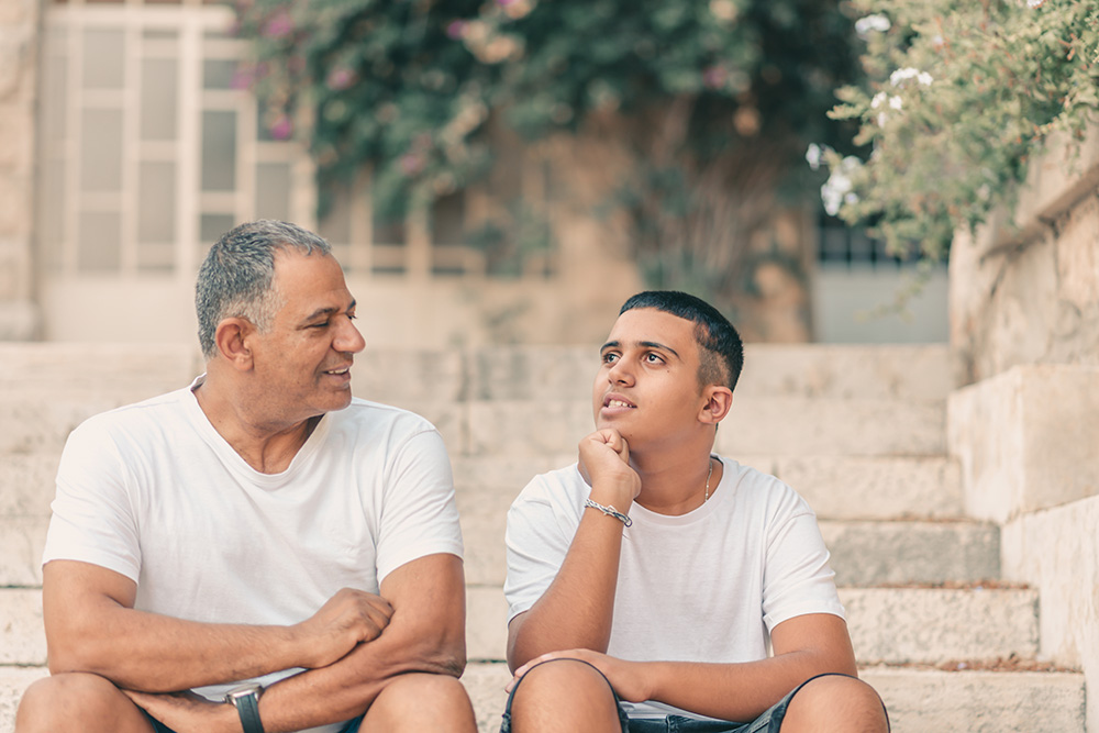 man and son discussing college