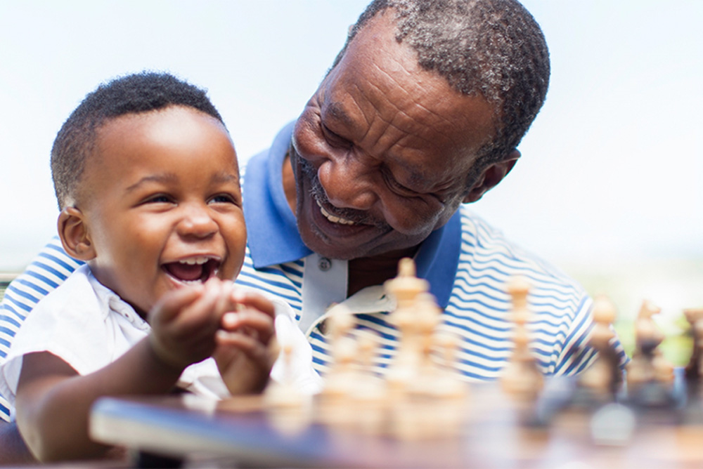Man and grandson playing together