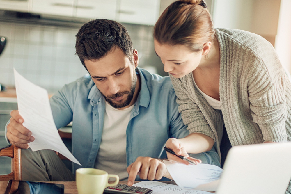 couple reviewing documents for retirement