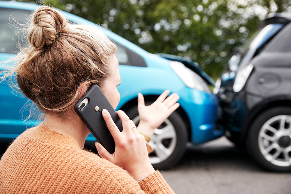 car accident women on phone