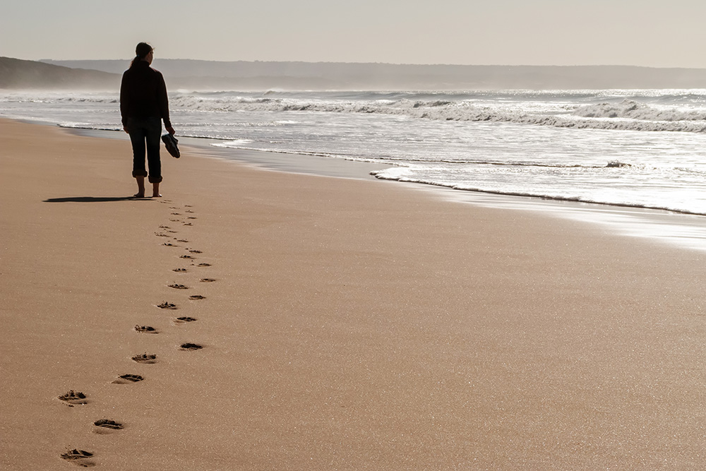 Someone walking in the sand