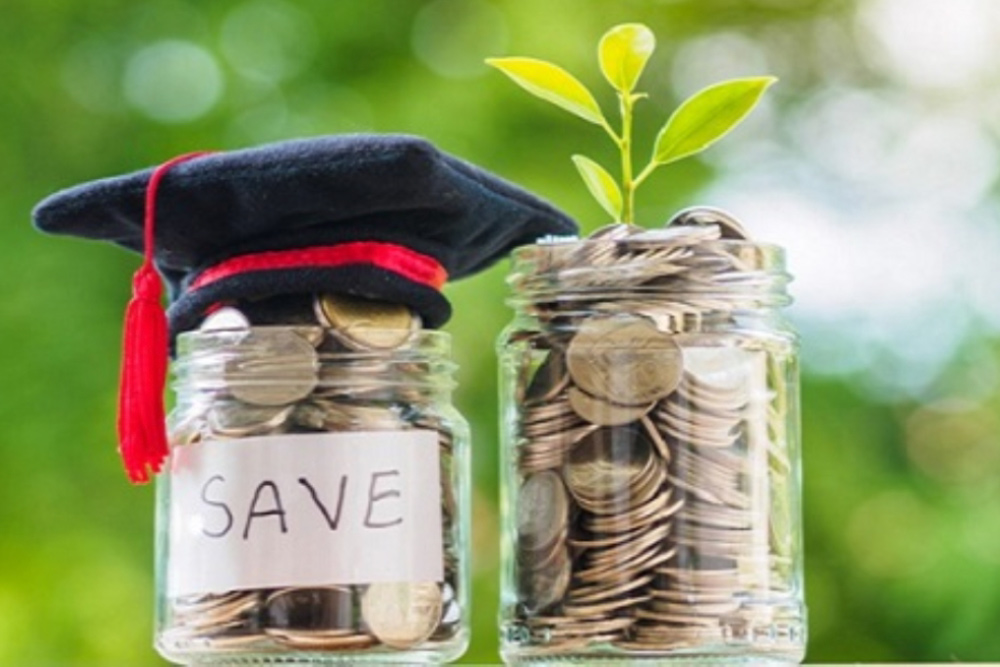 Two jars with money, one has a plant on top one has a graduation cap.