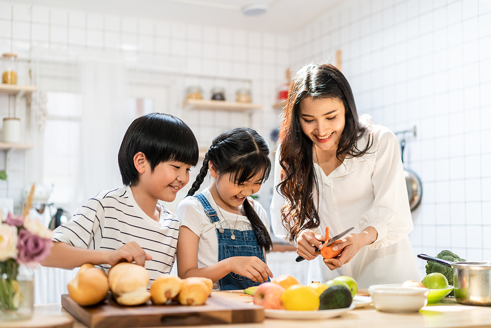 Asian family making food in kitchen at home.