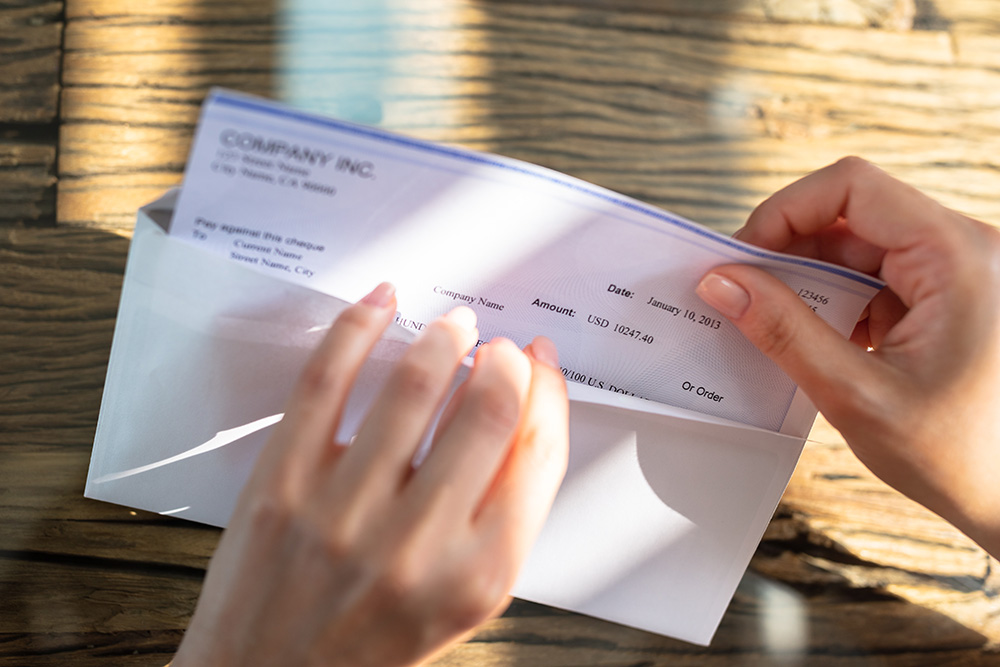 paycheck with envelope