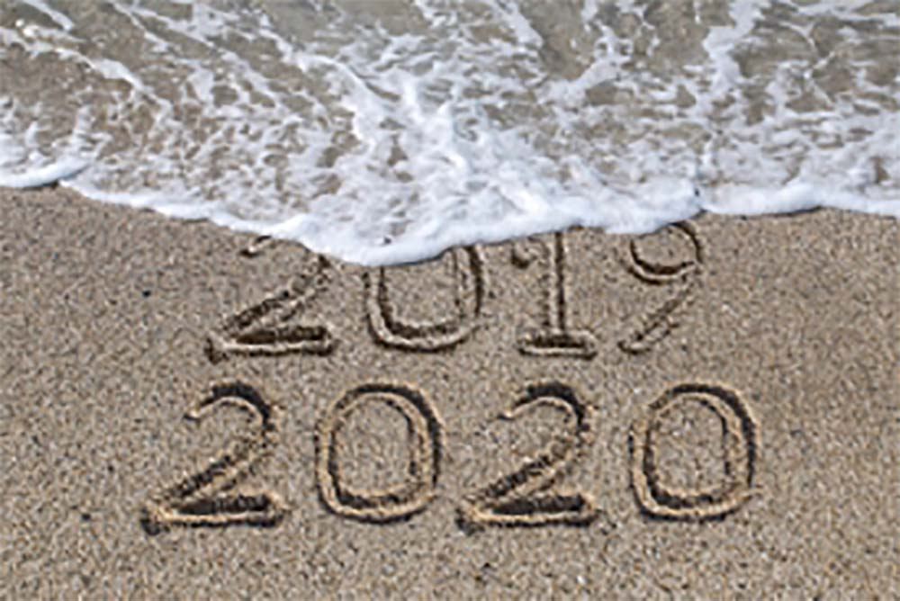 2019 and 2020 carved in sand